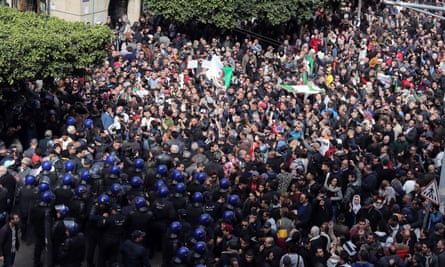 Riot police confront protesters in Algiers