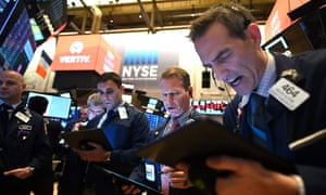 traders at the New York stock exchange opening on 28 February