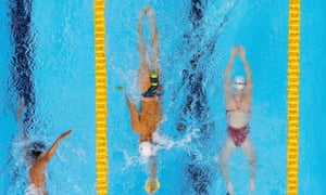 Swimmers practice at the Olympic swimming venue in Rio.
