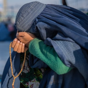 Women pray and cry at the shirne of Hazrat Ali, a holy pilgrimage site for bith Sunni and Shia Muslims. Many have travelled far to celebrate the New Year, but also reflect on the burdens and hardships of the previous year.