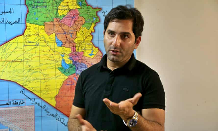 Raslan Haddad, the presenter of the local TV prank show, Tannab Raslan, stands in front of a map of Iraq during an interview with the Associated Press in Baghdad on Tuesday.