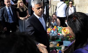 The mayor of London, Sadiq Khan, meets people near the scene of the Grenfell Tower fire.