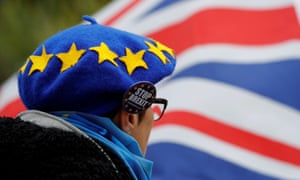 A man wearing a hat bearing the stars of the EU