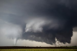 Three tornadoes touch down in fields south of Dodge City, Kansas on 24 May 2016 and this cyclic supercell produced at least 8 tornadoes.