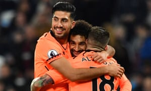 Alberto Moreno, right, and Emre Can congratulate Mohamed Salah on scoring against West Ham on 4 November.