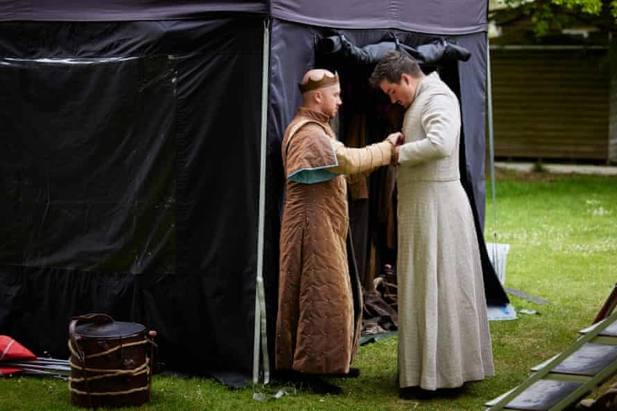 Laurie Scott (as Duncan) helps Michael Faulkner (as Malcolm) button up his coat. Each actor plays between two and four characters and costume changes must be be ready to come on to stage at the right moment.