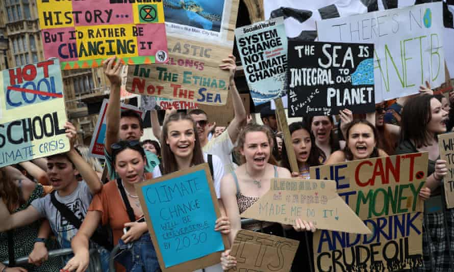 Students take part in a climate rally in Parliament Square, London