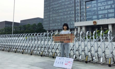 Howey Ou protesting outside government offices in Guilin, southern China