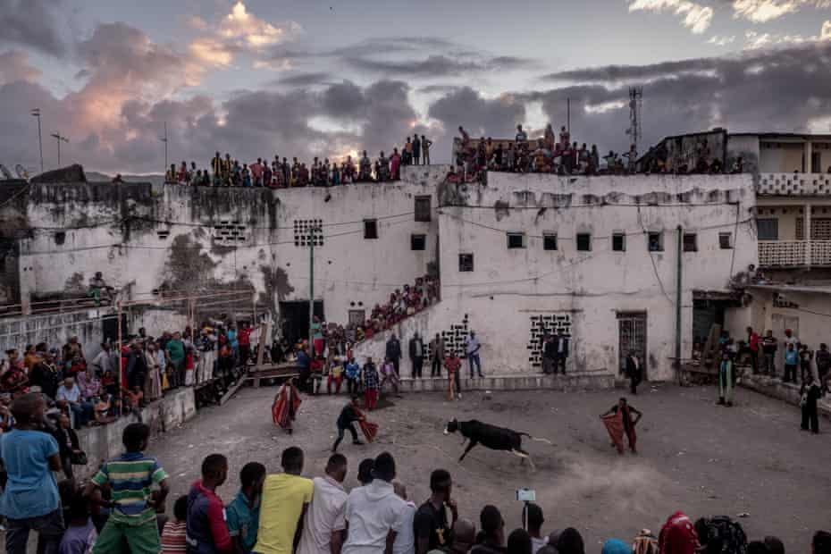 Spectators line the walls of the old sultan's palace to watch a bullfight