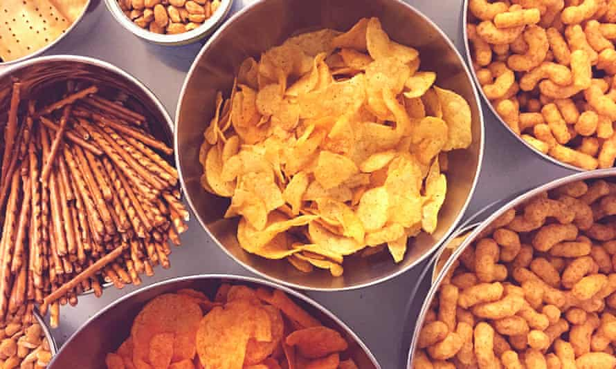 Bowls of crisps, nuts and other snacks