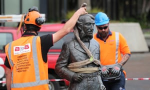 Workers remove the statue of Captain John Hamilton from Civic Square in Hamilton on Friday.