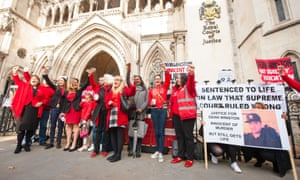 Members of Jengba demonstrate outside the Royal Courts of Justice in London.