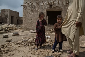 """Badshah Dullah, 40, is raising his family in the ruins of his family's hosue, destroyed 15 years ago in a US airstrike. The family was never able to come up with the funds to rebuild. """"This is all my children know,"""" he says. """"The war isn't over yet."""""""