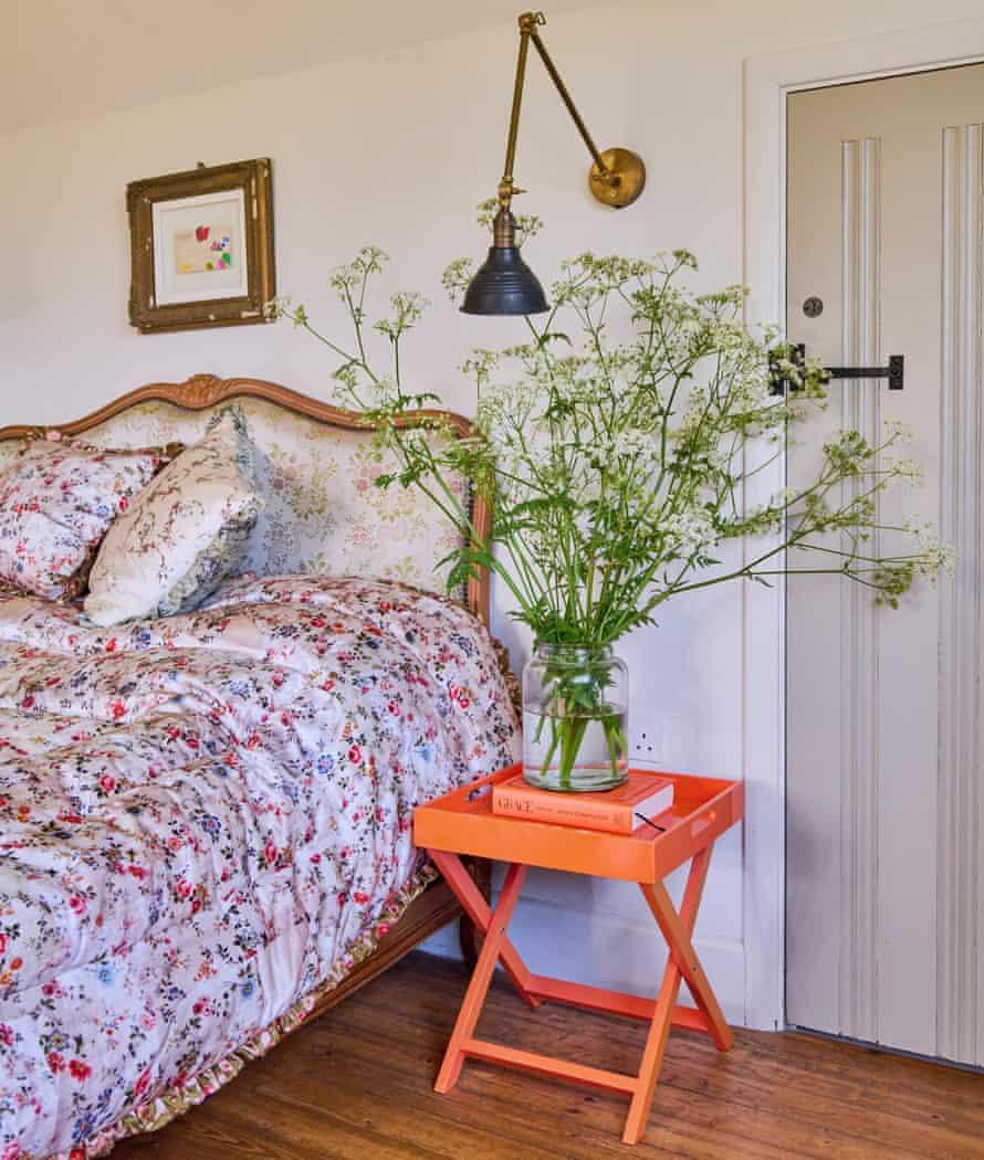 The master bedroom in the home of fashion designers Justin Thornton and Thea Bregazzi in Walberswick, Suffolk
