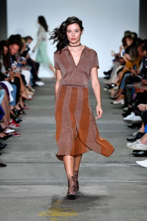 Find a flattering dress with a touch of shimmer, like this terracotta Hansen & Gretel dress, for a versatile summer option.