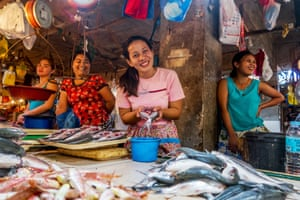 Fish stall, Carcar, Philippines. Walking through the market, I came across this stall and managed, through sign language – and a great deal of effort and laughter – to persuade the reluctant woman to hold the fish out towards me