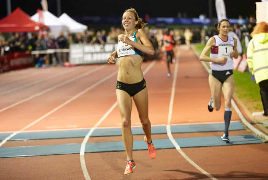 Jessica Andrews, who lapped Jo Pavey, right, savours her victory as she crosses the finish line.