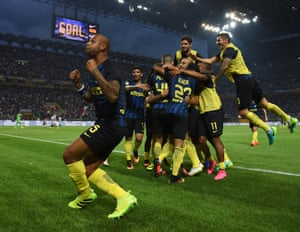 Ivan Perisic is mobbed by Inter team-mates after his goal as Felipe Melo celebrates, left.