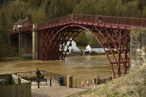 The swollen River Severn that broke its banks and breached emergency defences flows under the Iron Bridge in Ironbridge, Shropshire
