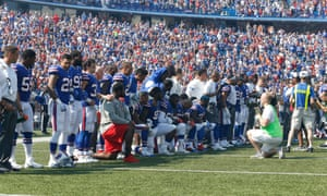Buffalo Bills players kneel in protest during the national anthem before Sunday's game against the Denver Broncos.
