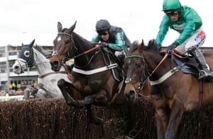 Nico de Boinville with Altior (centre) jump the final fence in second behind Sceau Royal (right) but came back to win the Queen Mother Champion Chase.