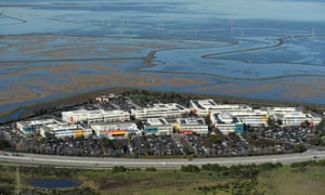 An aerial view of the Facebook campus on the edge of the San Francisco Bay. The land that the homeless encampments are on lies across the main road.