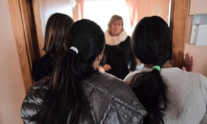 "ROMANIA-CHILDREN-TRAFFICKING-CRIMEIana Matei (C), a Romanian psychologist who takes care of minors who have been victims of human trafficking talks with some of the girls there at the reception center near Pitesti city, southern Romania on January 27, 2017. At the reception center set up near Pitesti by the ""Reaching Out"" association eleven teenagers watch TV, embroidery or tease each other about their favorite stars. All to forget the sufferings. According to official figures, 695 victims of trafficking were identified in 2016 in Romania, compared with 880 the previous year. Most are exploited by networks of Romanian traffickers operating in Italy, Spain, Germany and France. Some of them managed to escape, but ""it is mainly"