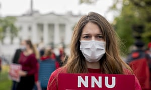 A member of National Nurses United (NNU) demonstrates outside the White House in April amid calls for adequate personal protective equipment.