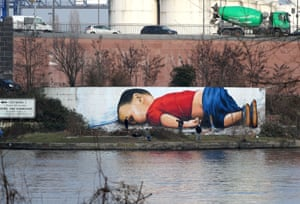 A graffiti by artists Justus Becker and Oguz Sen depicts the drowned Syrian refugee boy Alan Kurdi (initially reported as Aylan Kurdi) at the harbour in Frankfurt am Main, Germany, on March 10, 2016.