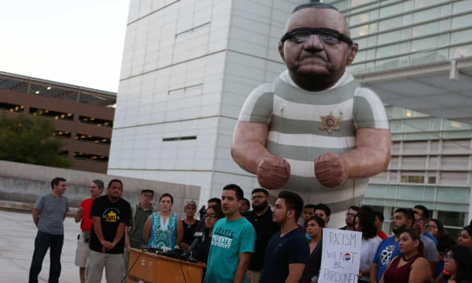 Local immigrants rights organizations protest the pardoning of Joe Arpaio in Phoenix, Arizona, on 25 August.