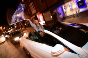 Leicester City fans celebrate in their cars after their team's improbable title win.