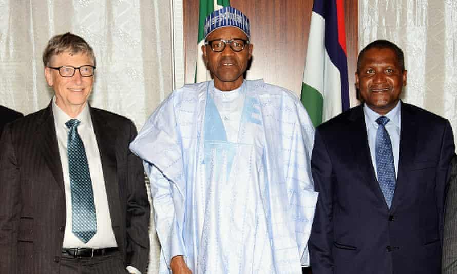 The Nigerian president Mohammadu Buhari is flanked by Bill Gates, left, and Aliko Dangote
