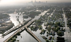 Floodwaters from Hurricane Katrina fill the streets near downtown New Orleans. This summer the city suffered two so-called 100-year storms over just two months.
