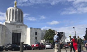 Republican senators who fled the Oregon state house to block passage of 'cap and trade' legislation were offered protection from 'patriot movement' groups.
