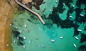 """Blue waters in Bretagne, Tregastel and the amazing """"cote de Granite rose""""This photo was taken in Tregastel near Perros-Guirrec .This is the cote de Granit Rose with beautiful blue waters rocks and boats. This is an aerial photo."""