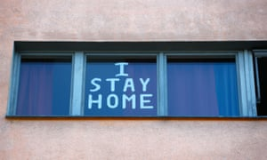 'I stay at home' is seen at a residential building in Berlin, Germany.