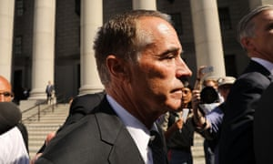 Chris Collins walks out of a New York court house after being charged with insider trading.