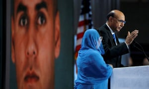 Khizr and Ghazala Khan stand in front of a portrait of their son at the Democratic national convention.