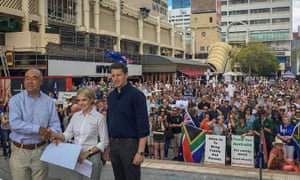 Ian Goodenough (left) and Andrew Hastie (right) at a rally for white South African farmers in Perth last year. The two Liberal MPs met briefly with far-right extremist Neil Erikson at the rally.