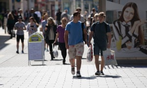Shoppers walk past shops on the main shopping street in Broadmead, Bristol.