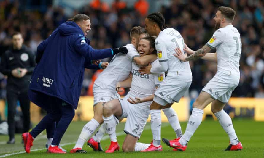 Teammates congratulate Luke Ayling on scoring Leeds' opening goal against Huddersfield on 7 March