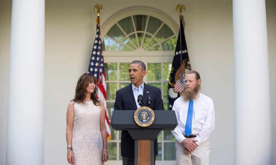 Barack Obama stands with Bowe's parents, Jani and Bob Bergdahl, in May 2014 during a news conference about the release of their son.