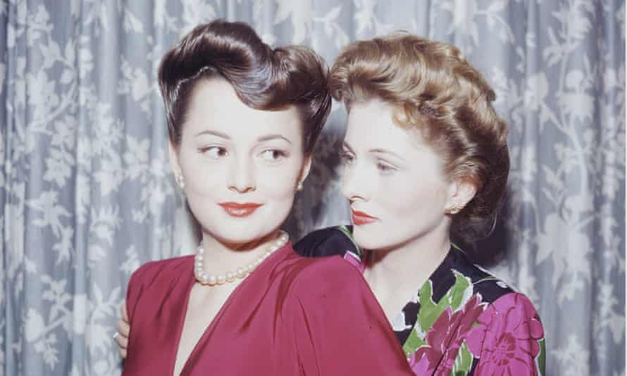 Olivia de Havilland, left, with her sister, Joan Fontaine, circa 1945.
