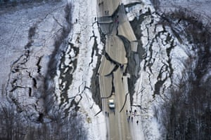 A car is trapped on a road damaged by two earthquakes south of Wasilla in Alaska.