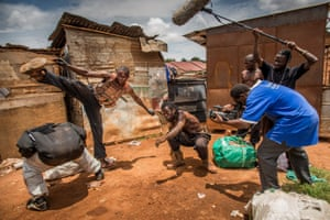 Isaac Nabwana shoots a fight scene adjusted by Ivan stuntman, Martial Art teacher and member of the Ugandan Kung Fu national team, Charles Bukenya and Henry the « Barbarian ».