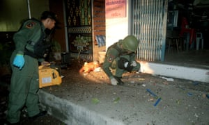 Members of the Explosive Ordnance Disposal unit inspect a bomb blast scene in Yala province, one of 17 such sites on the night of 14-15 May.