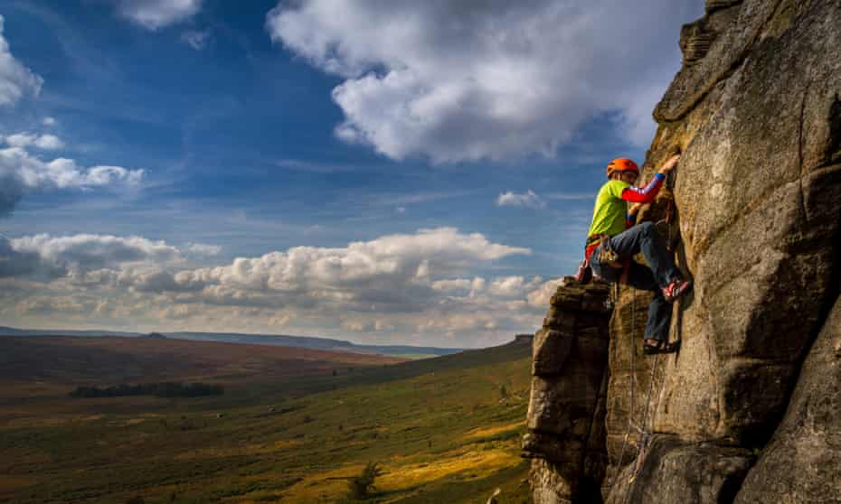 A rock climber on the Stretcher route at Stanage Edge.