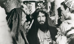 George Harrison cameos in Life of Brian, with Eric Idle and John Cleese.