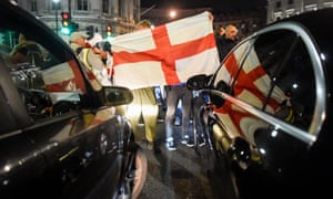 A St George's flag is held up as pro-Brexit supporters block traffic in Trafalgar Square, London, in March 2019