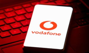 A Vodafone logo on a smartphone